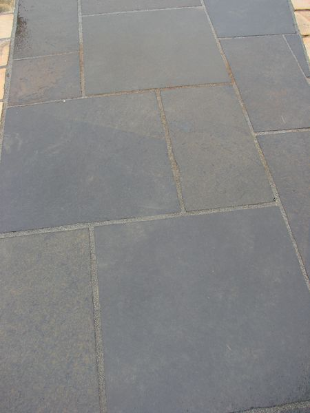 smooth finish black with brown limestone paving